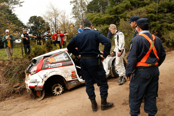 Ott Tanak (EST) Ford Fiesta R5 looks at his damaged car after crashing out of the rally. FIA World Rally Championship, Rd5, Rally Argentina, Day Three, Cordoba-Villa Carlos Paz, Argentina, 11 May 2014.